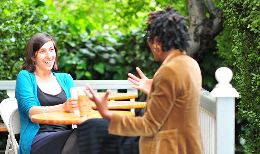 two women faculty talking